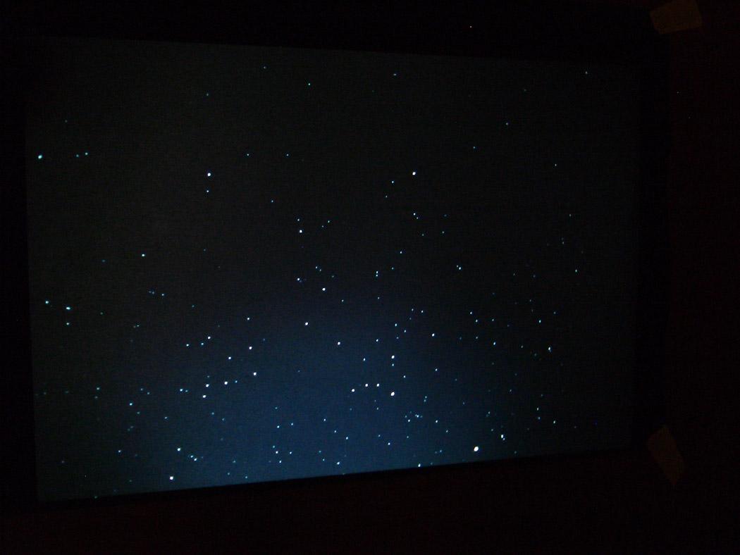 Alberto Tadiello, Come abitando in prossimità, diapositive, proiettore Kodak Carousel, foglio A4 nero 21 x 29,7 cm, 2007.
